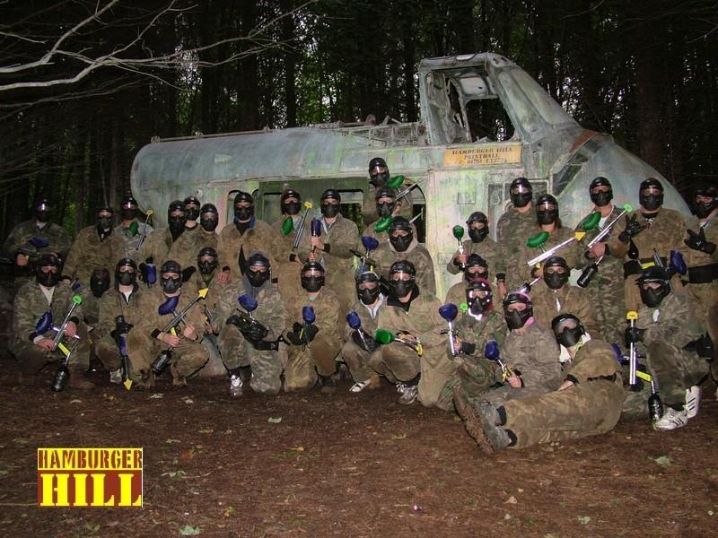 A Paintballing group photographed in front of our Skiworksi Helicopter
